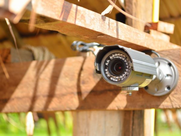 21932235 – security camera on the wood wall
