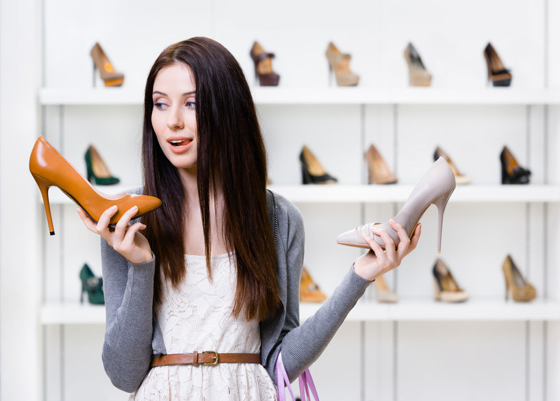 Woman can't choose high heeled shoes
