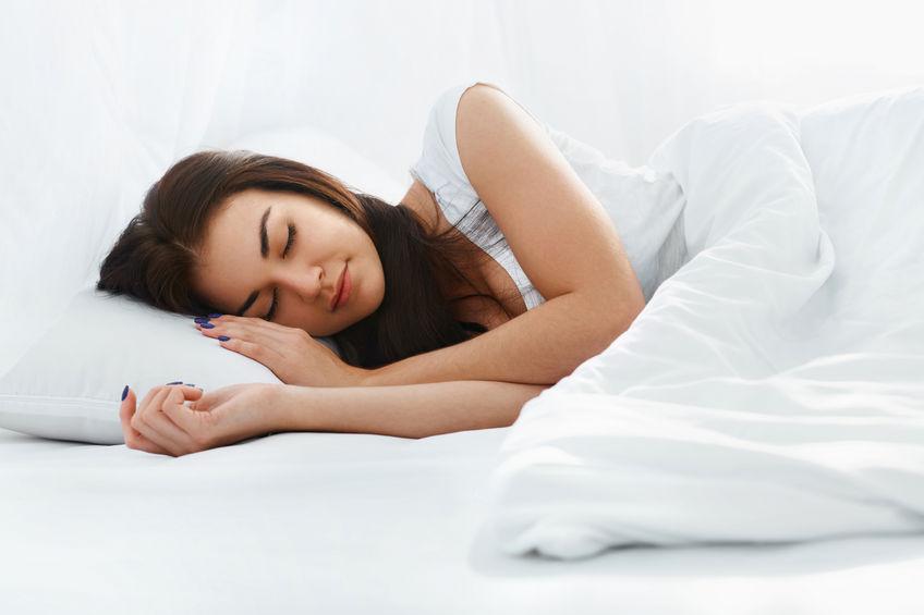 Beautiful girl sleeping in the bedroom