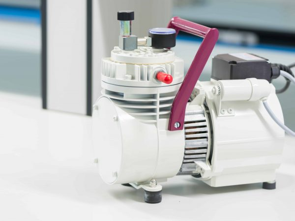 small white air compressor for science experiment Laboratory