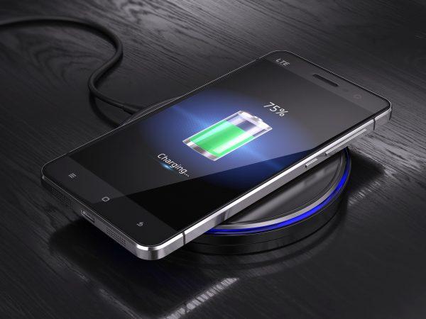 Wireless charging of smartphone – 3d render