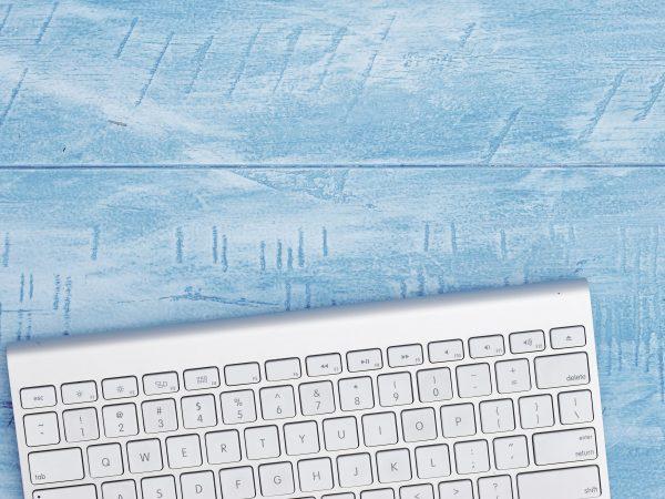 A studio photo of a wireless computer keyboard
