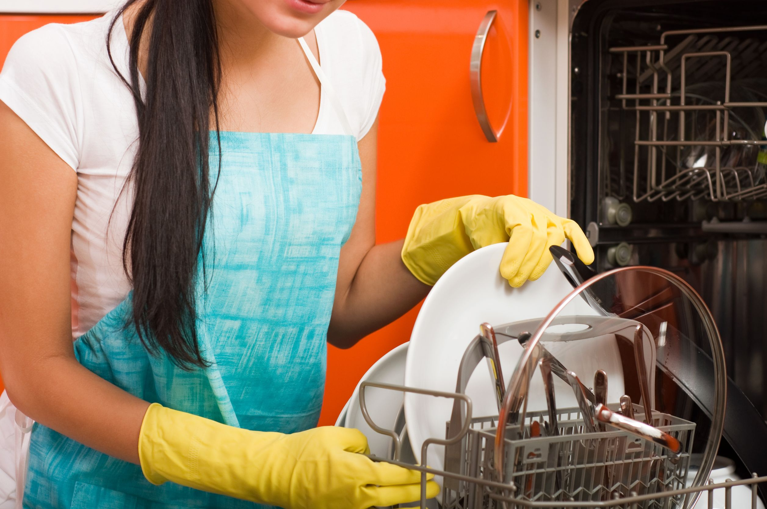 woman cleaning kitchen using dish washing machine.