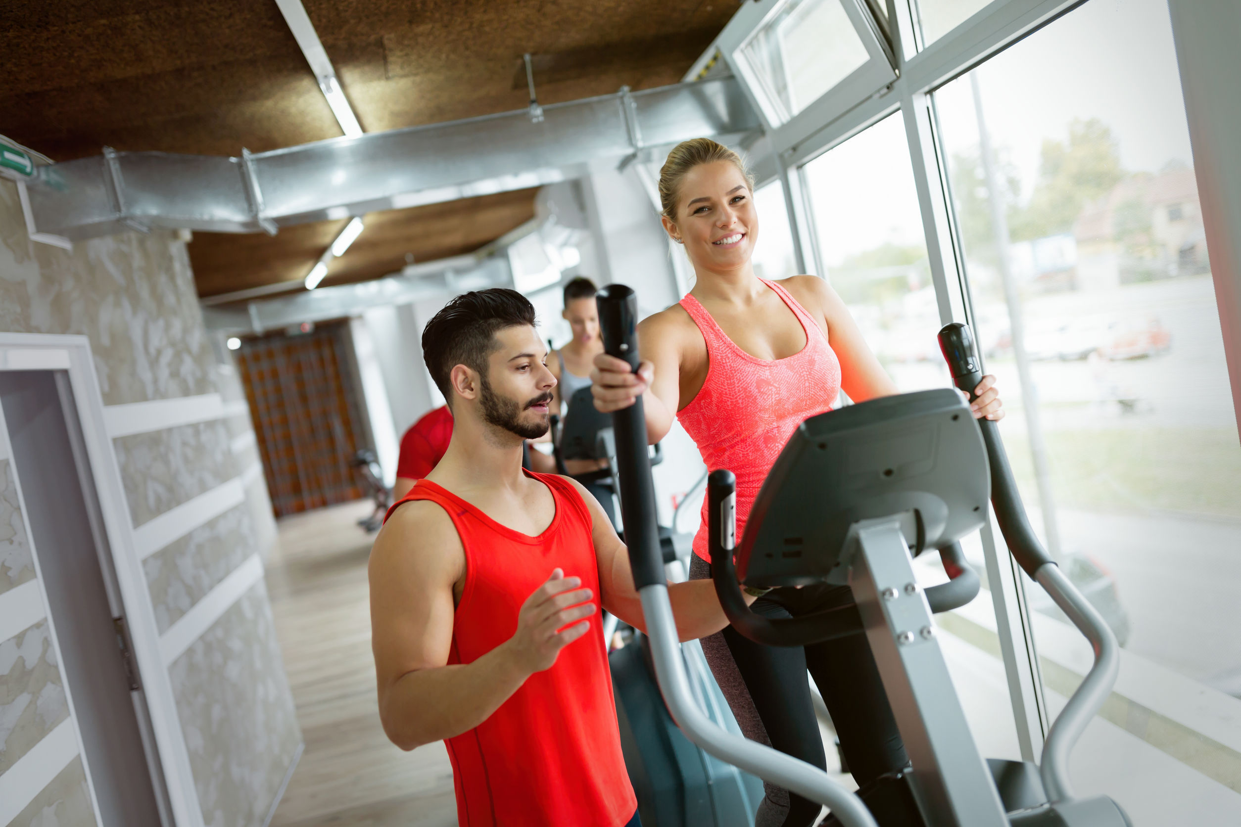 Attractive woman working cardio exercises with trainer