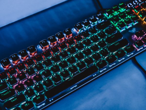 Colorful keyboard for gaming. Backlit keyboard with versatile color schemes. Colorful light keyboard.